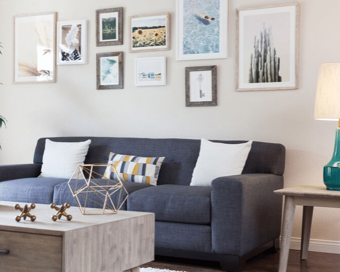 living room table, couch, and framed photos on the wall
